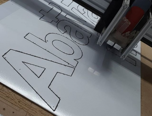 Cutting letters. Making a signboard for albyan foundation Big Print Birmingham 07702153393